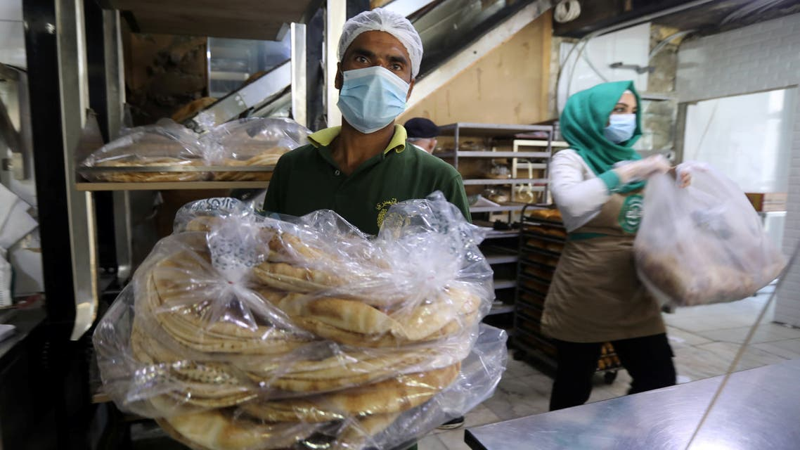 Workers carry bread inside a bakery in Beirut, following Tuesday's blast in city's port area, Lebanon August 5, 2020. REUTERS/Mohamed Azakir
