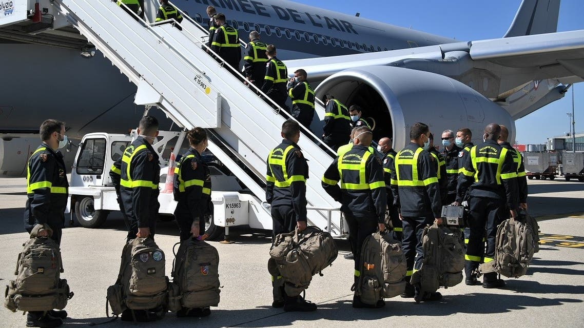 French Securite Civile (Civil Security) personnel board a Airbus A330, at Roissy airport near Paris, on August 5, 2020, as France is sending search and rescue experts aboard three military planes loaded with a mobile clinic and tonnes of medical equipment to Beirut. (AFP)
