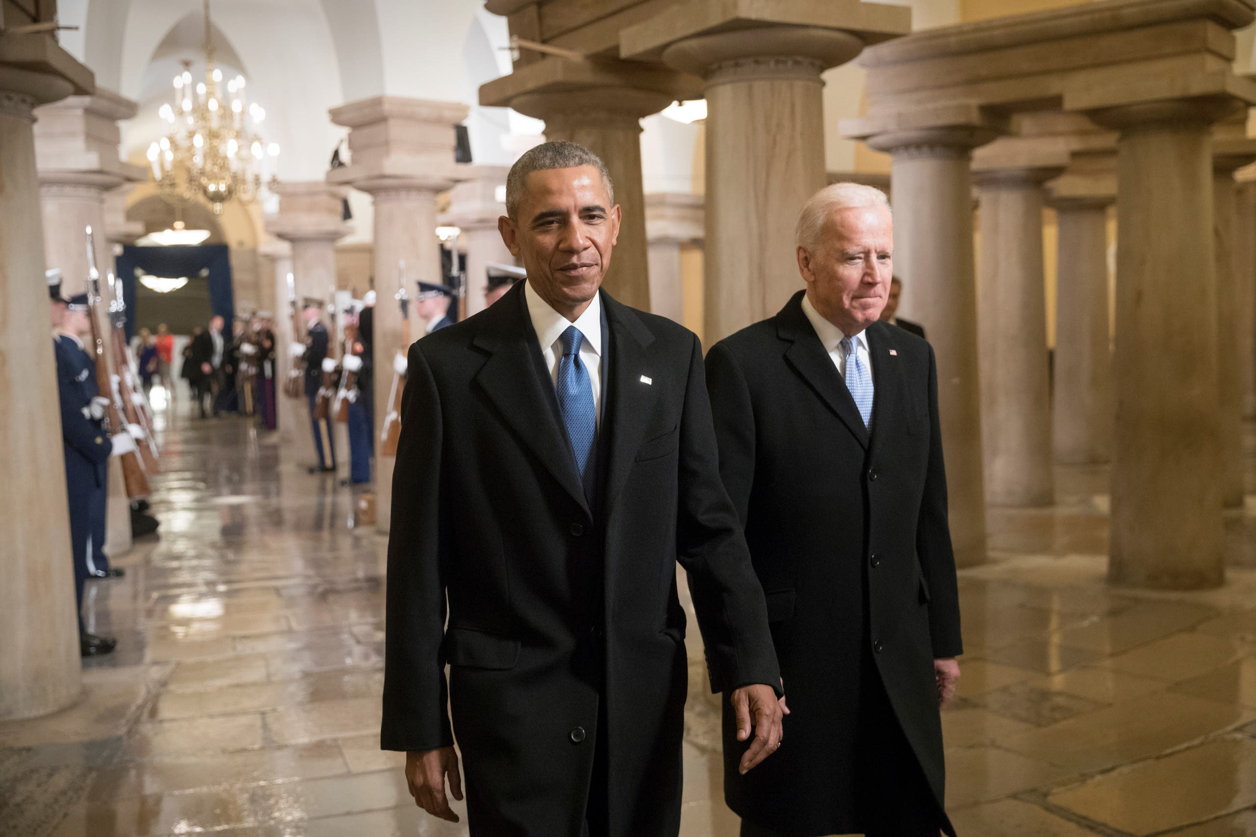 Then-President Barack Obama and Vice President Joe Biden walk through the Crypt of the Capitol for Donald Trump's inauguration ceremony, in Washington, Friday, Jan. 20, 2017. (Reuters)