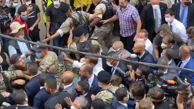 وسطهم رئيس فرنسا.. لبنانيون: الشعب يريد إسقاط النظام