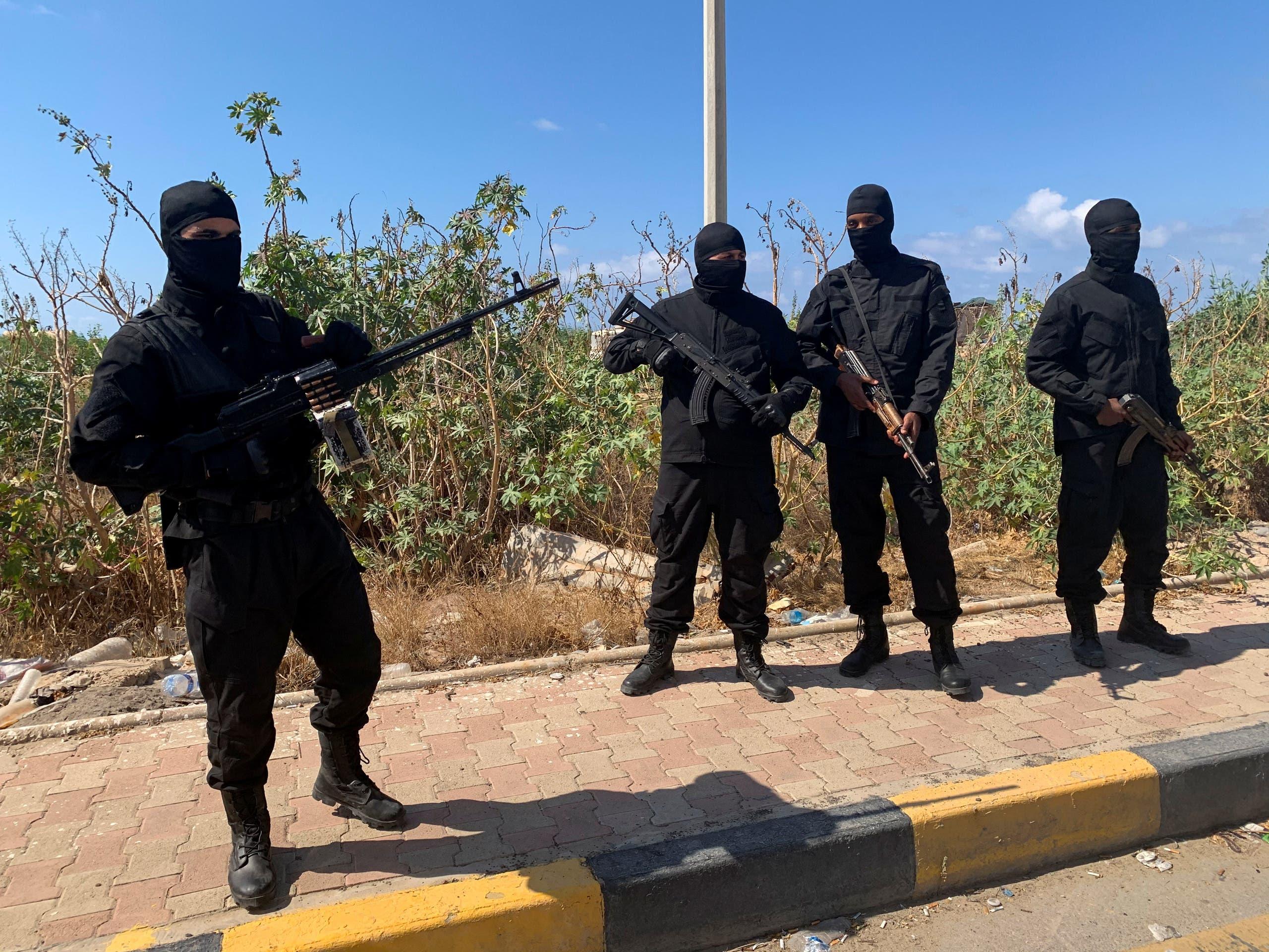 مسلحون في شوارع طرابلس الليبية(أرشيفية- رويترز)