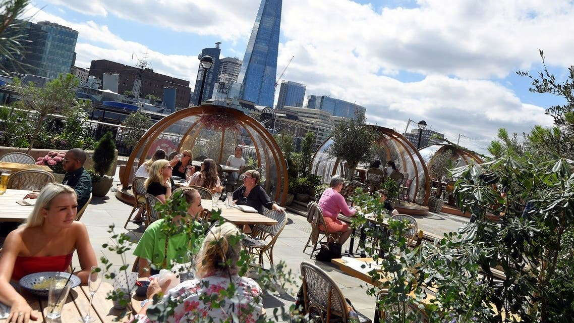 People eat outside and inside private dining pods, on the terrace of a restaurant, as the outbreak of the coronavirus disease (COVID-19) continues, in London, Britain, August 6, 2020. REUTERS