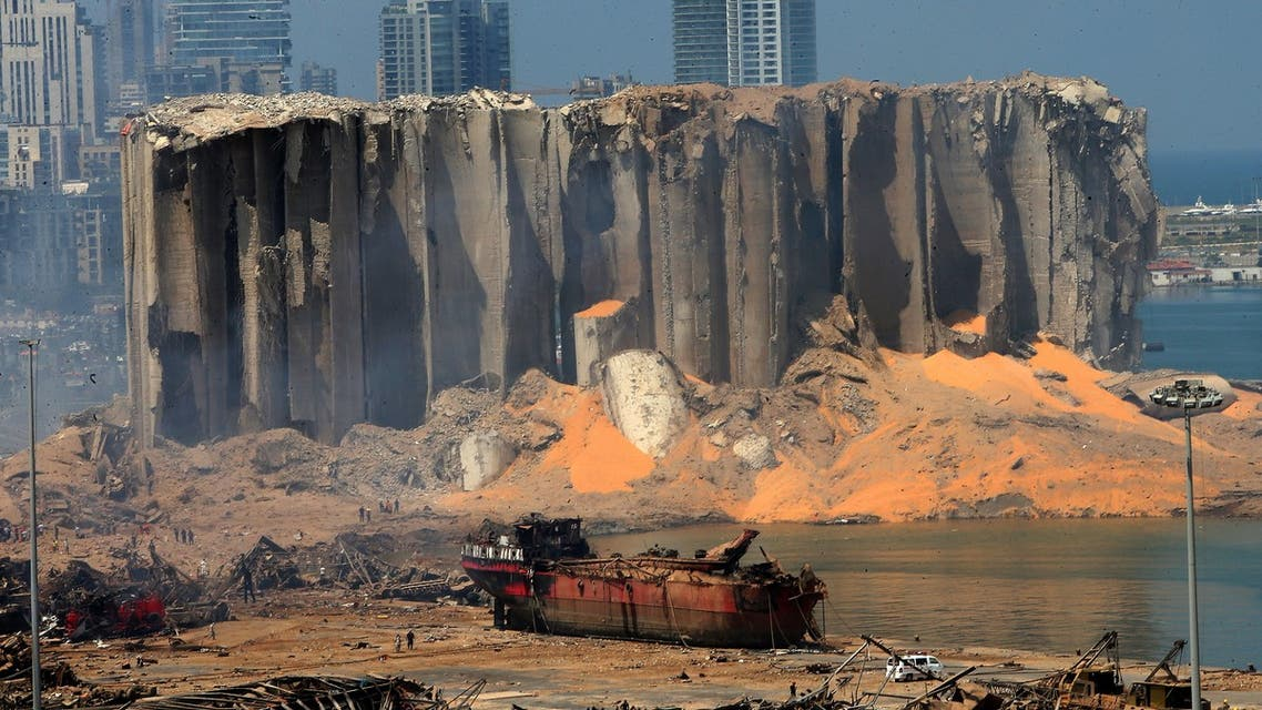 A picture taken on August 5, 2020 shows the damaged grain silo and a burnt boat at Beirut's harbour, one day after a powerful twin explosion tore through Lebanon's capital, resulting from the ignition of a huge depot of ammonium nitrate at the city's main port. Rescuers searched for survivors in Beirut after a cataclysmic explosion at the port sowed devastation across entire neighbourhoods, killing more than 100 people, wounding thousands and plunging Lebanon deeper into crisis. The blast, which appeared to have been caused by a fire igniting 2,750 tonnes of ammonium nitrate left unsecured in a warehouse, was felt as far away as Cyprus, some 150 miles (240 kilometres) to the northwest.