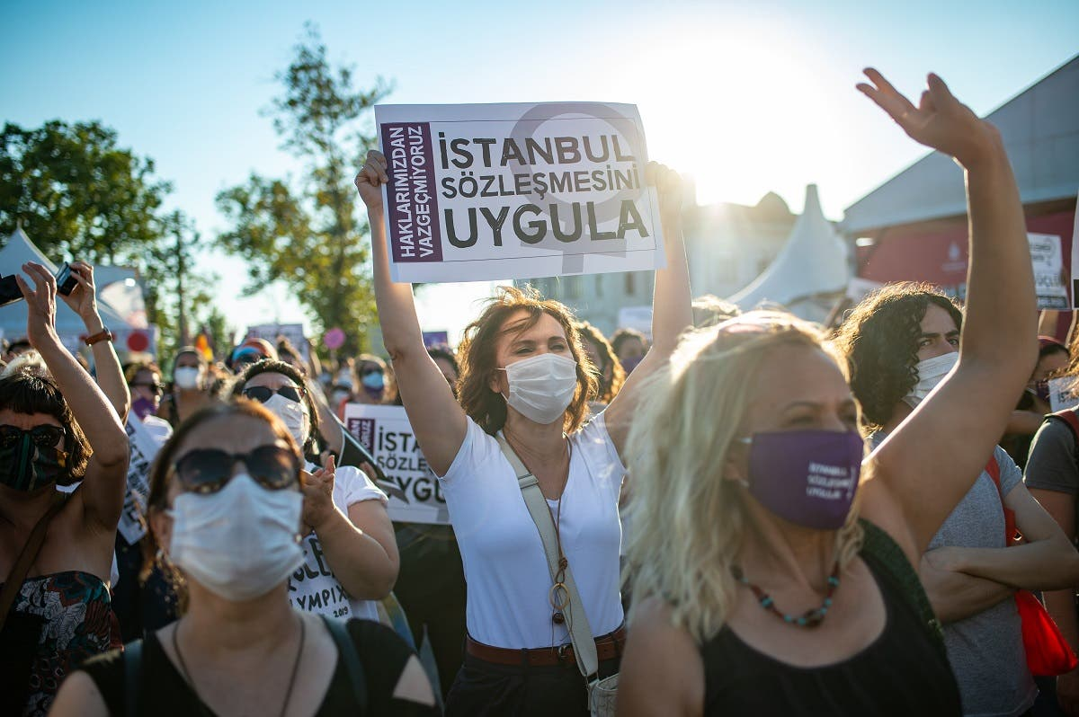 Demonstrators hold up placards during a demonstration for a better implementation of the Istanbul Convention to prevent and combat violence against women, in Istanbul, Turkey, on August 5, 2020. (AFP)