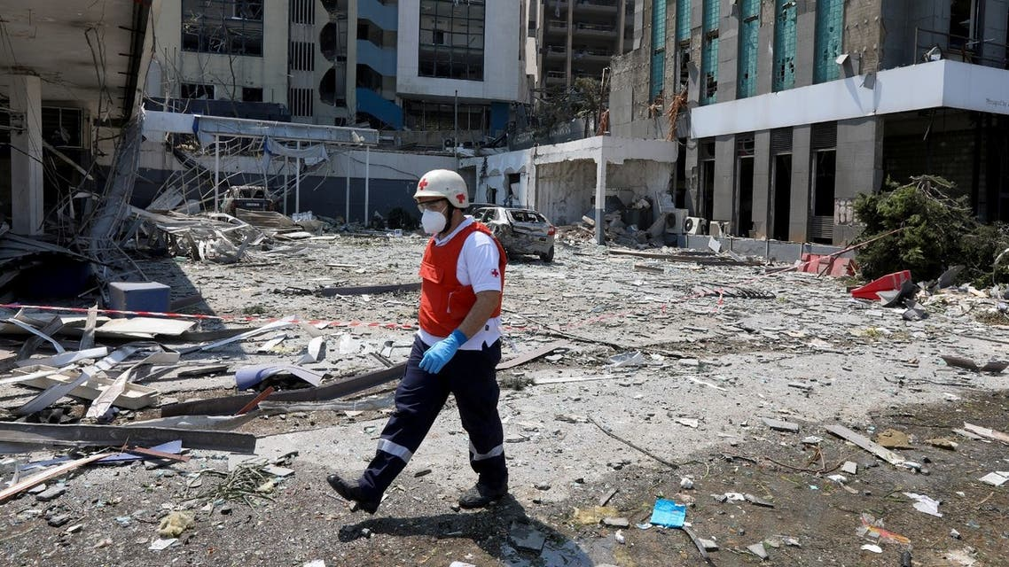 A Lebanese Red Cross member walks among the debris from damaged buildings following Tuesday's blast in Beirut's port area, Lebanon August 5, 2020. (Reuters)