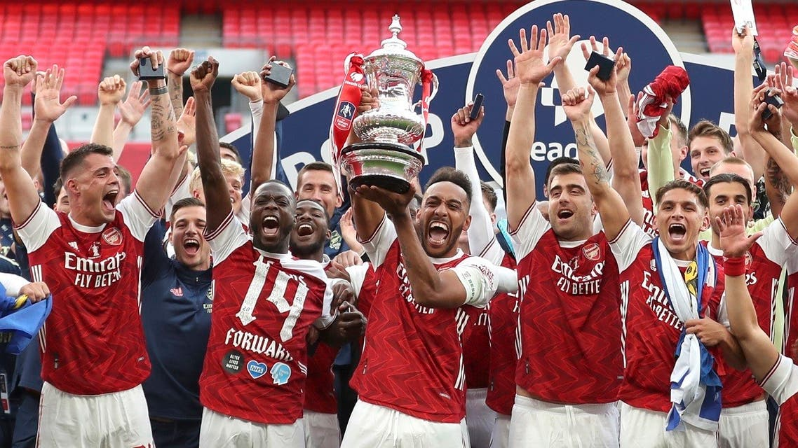 Arsenal's players celebrate with the trophy after the FA Cup final soccer match between Arsenal and Chelsea at Wembley stadium in London, England, on August 1, 2020. (AP)