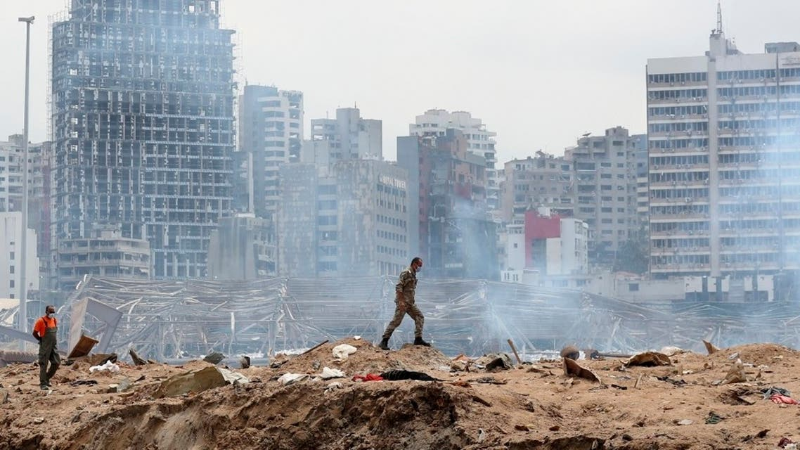 A soldier walks at the devastated site of the explosion in the port of Beirut, Lebanon, Aug.6, 2020. (AP)