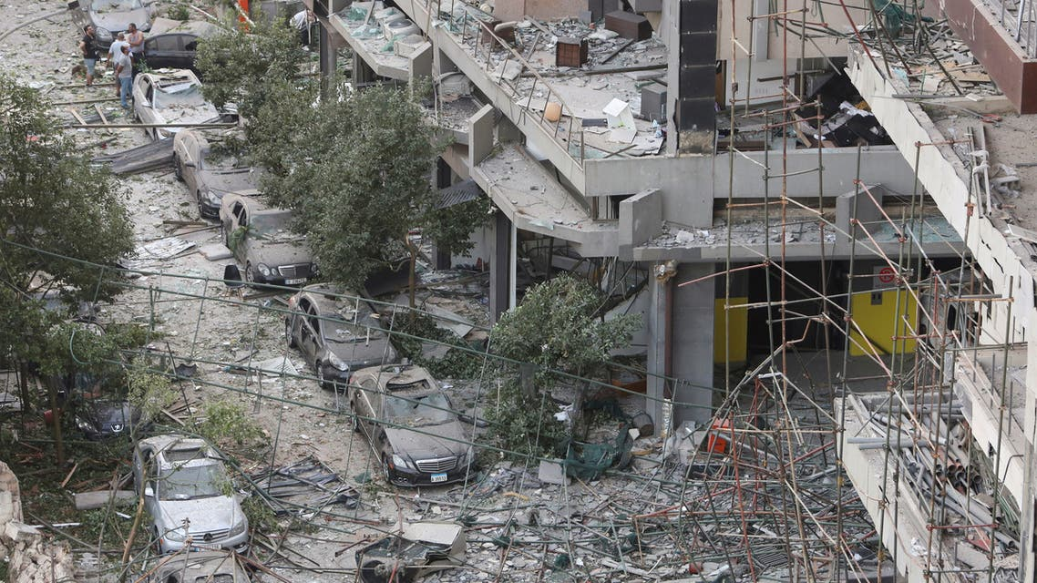 FILE PHOTO: People inspect the damage near the site of Tuesday's blast in Beirut's port area, Lebanon, August 5, 2020. REUTERS/Aziz Taher/File Photo