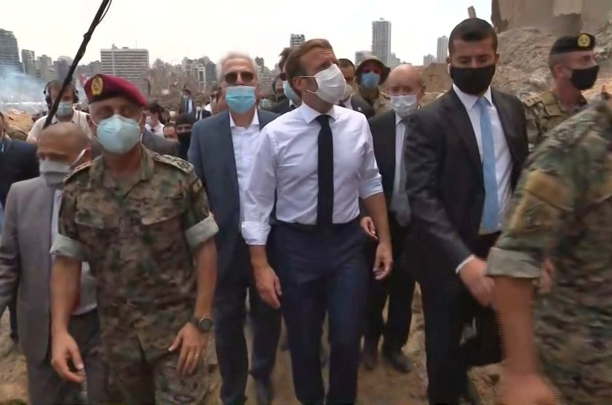 A video grab shows French President Emmmanuel Macron (C) inspecting the damages at the port of Lebanon's capital Beirut, on August 6, 2020. (AFP)