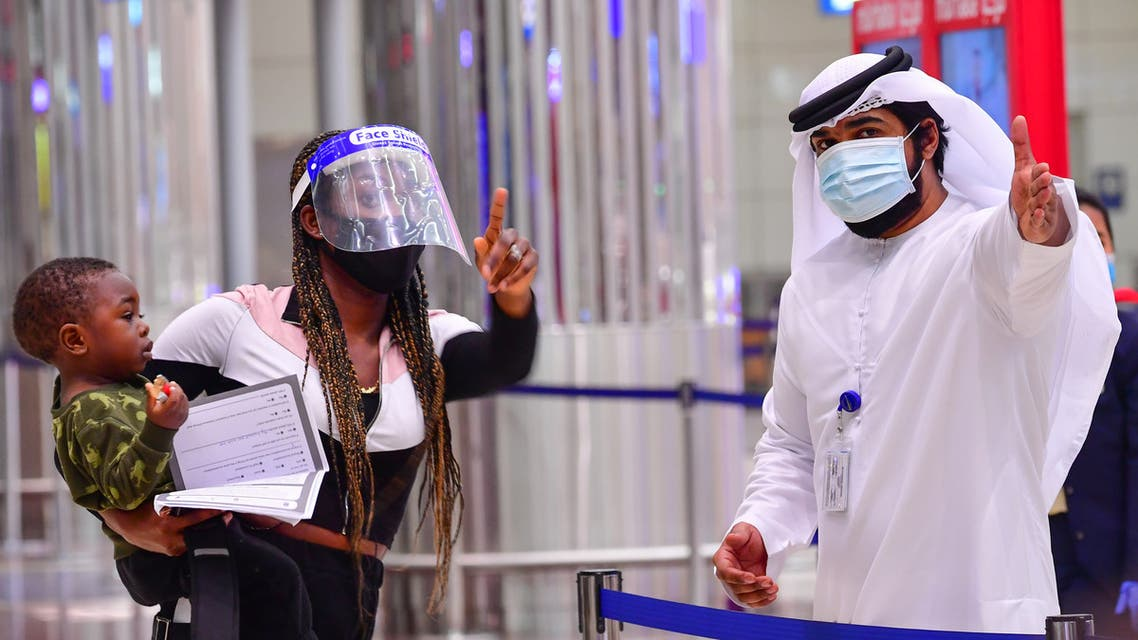A tourist receives instruction at Dubai airport in the United Arab Emirates on July 8, 2020. (AFP)