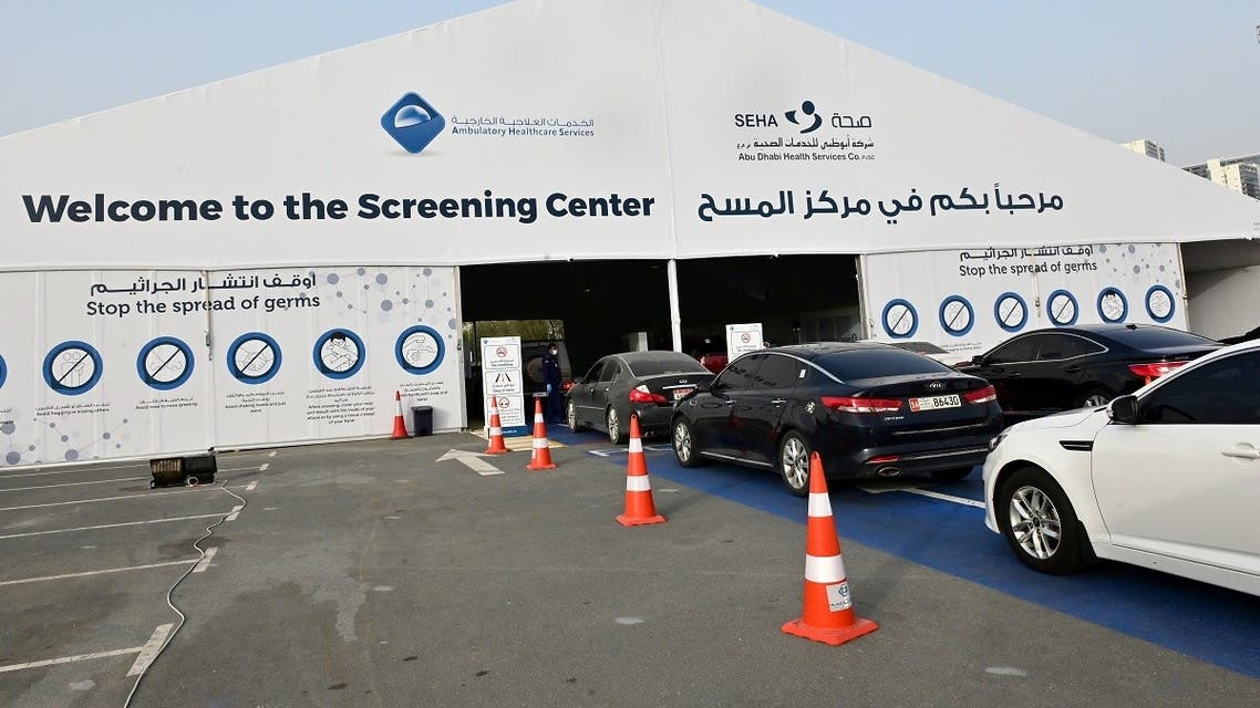 Cars line up as people wait to enter a drive thru testing centre for the COVID-19 coronavirus in the Emirati capital Abu Dhabi on April 2, 2020. (AFP)
