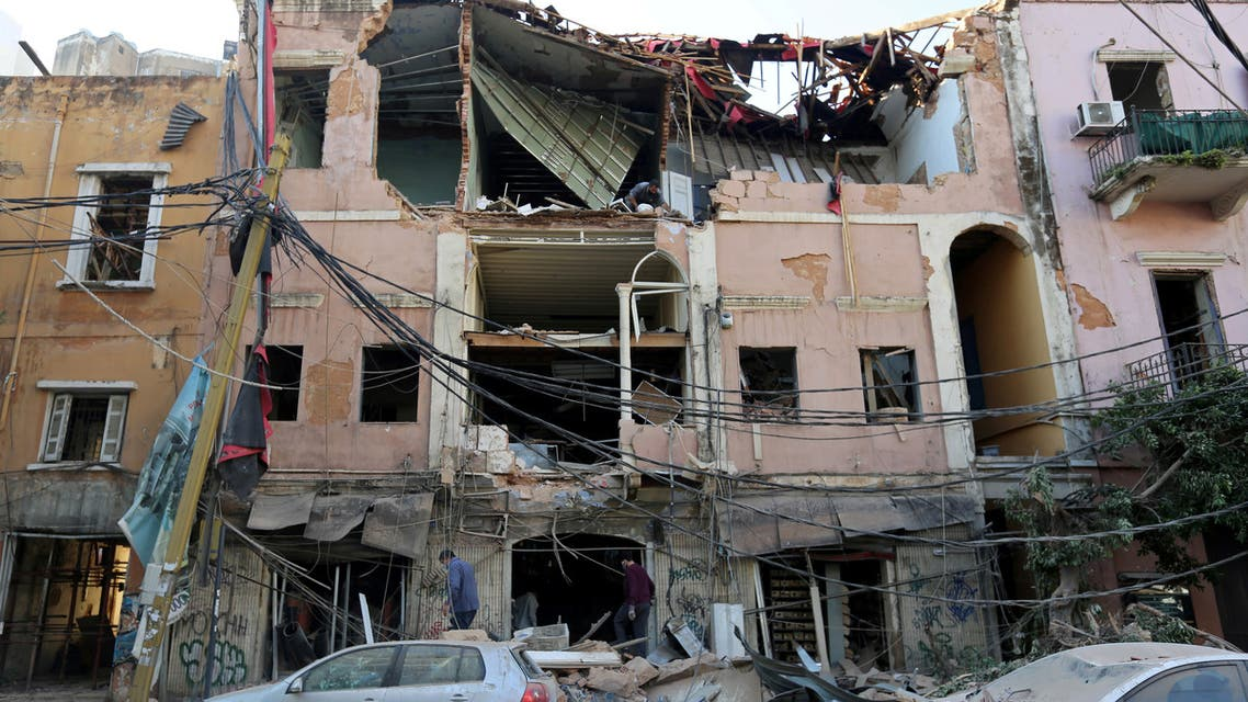 FILE PHOTO: Men inspect a damaged building near the site of Tuesday's blast in Beirut's port area, Lebanon, August 5, 2020. REUTERS/Aziz Taher/File Photo