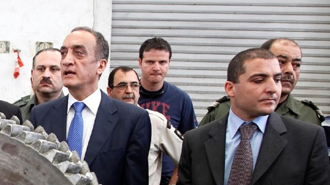Former Lebanese Customs chief Shafik Merhi (C) and current Customs chief Badri Daher (R) are seen in this picture at the Port of Beirut, May 17, 2010. (File Photo: AP)