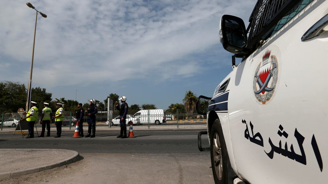 Police and security officials stand guard at a checkpoint on a highway in Sanabis west of Manama, Bahrain. (File photo: Reuters)