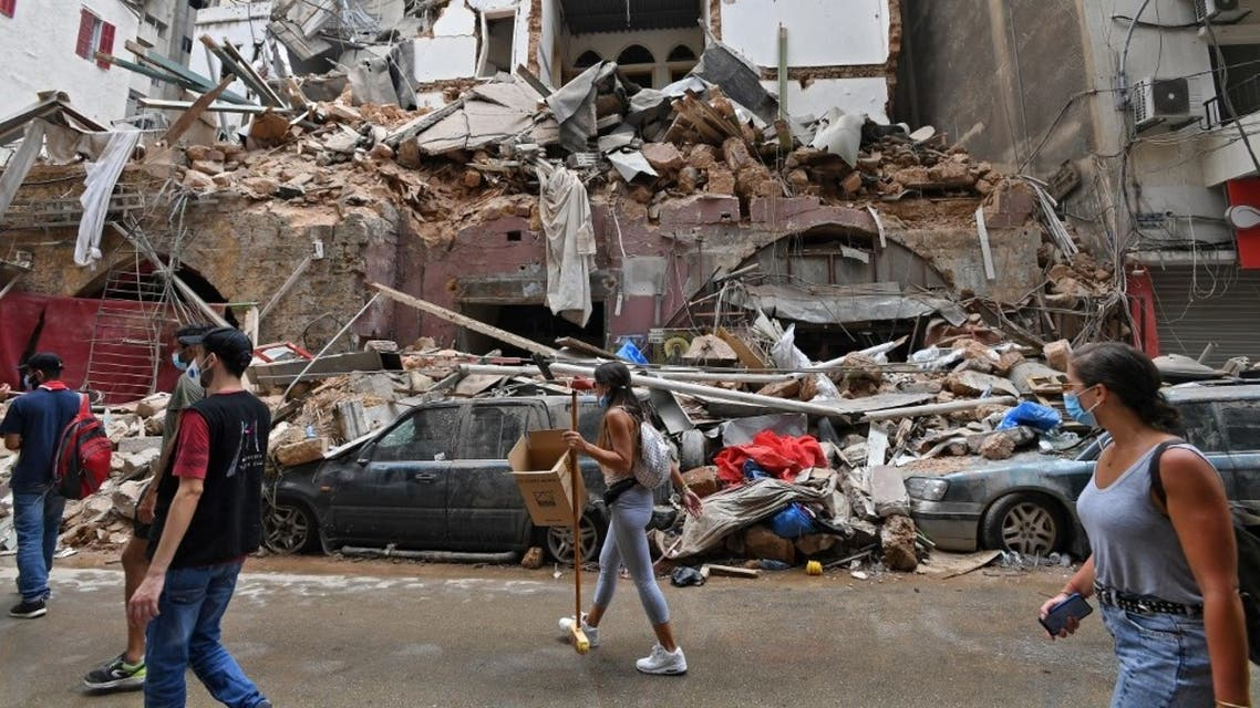 Lebanese volunteers clear the rubble at the devastated Gemmayzeh neighbourhood, on August 7, 2020, in the aftermath of a massive blast which shook the capital Beirut. (AFP)
