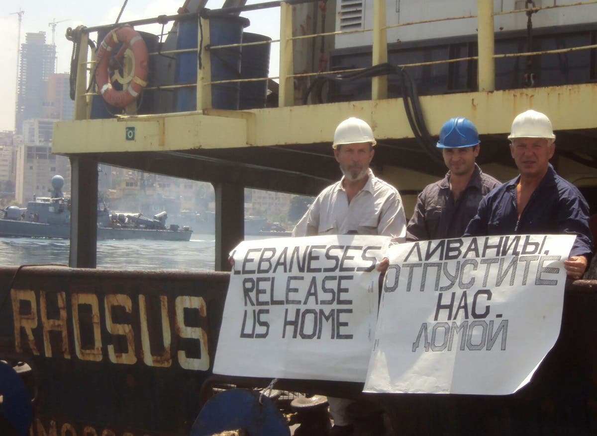 Captain Boris Prokoshev and crew members demand their release from the arrested cargo vessel Rhosus in the Port of Beirut, in a summer 2014 photograph. (File Photo: Reuters)