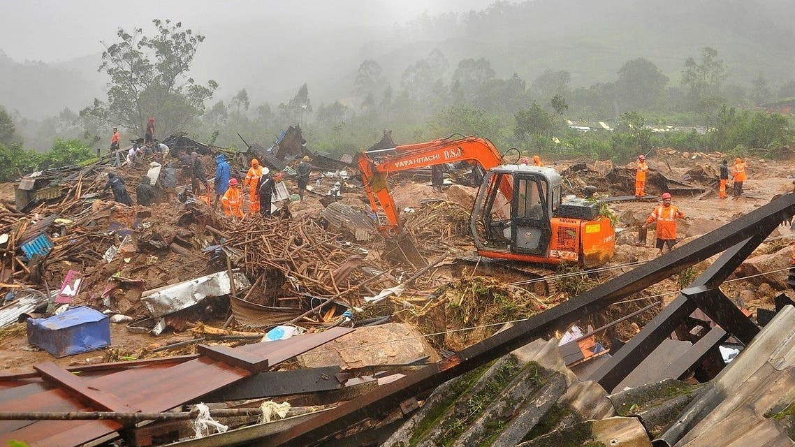 Rescue workers look for survivors at the site of a landslide during heavy rains in Idukki, Kerala, India, August 7, 2020. REUTERs