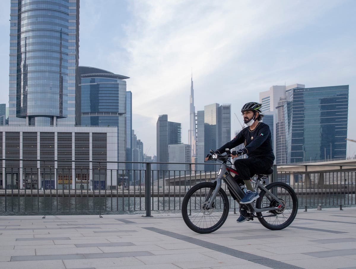 Sheikh Mohammed seen cycling with Burj Khalifa seen in the background. (Dubai Media Office)