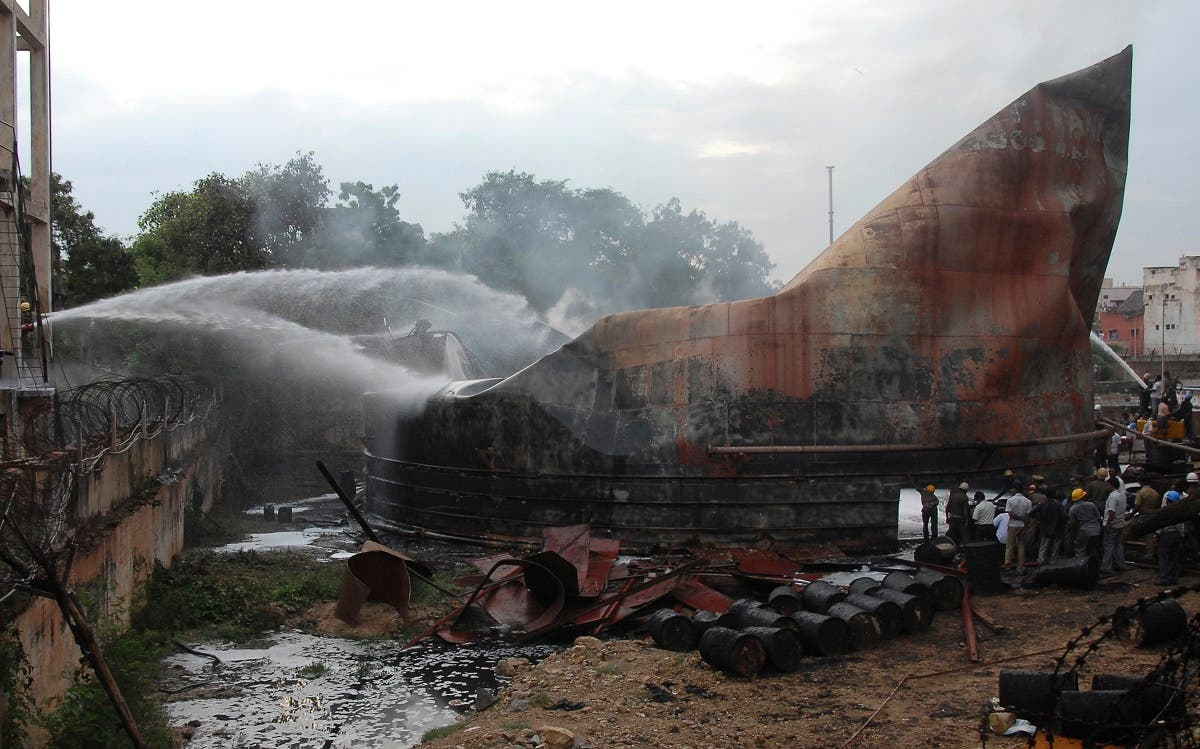 File photo of firefighters try to douse a fire from an oil tanker at a port in the southern Indian city of Chennai.  (Reuters)