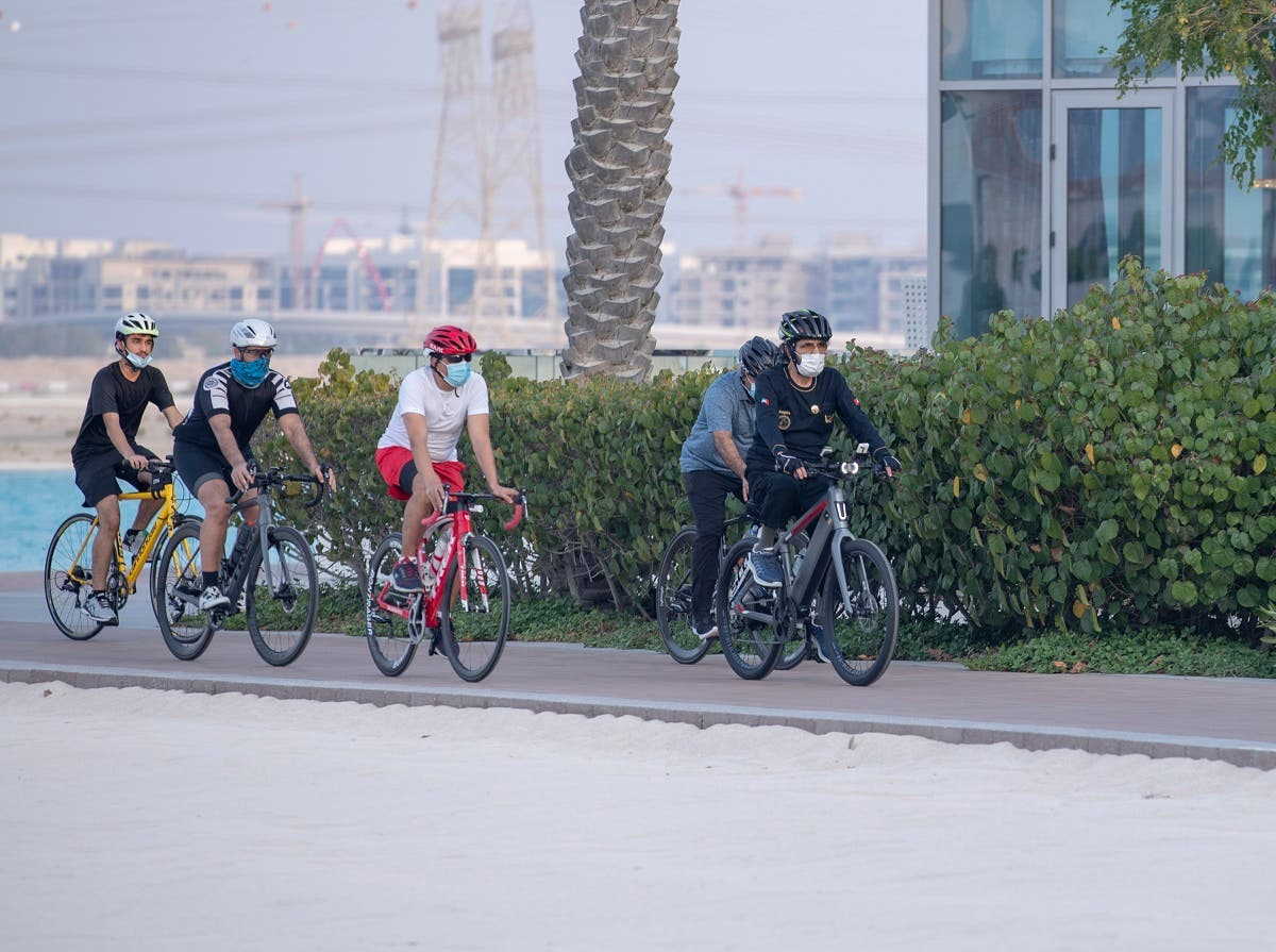 Sheikh Mohammed enjoying the outdoors on his cycle along with associates. (Dubai Media City)