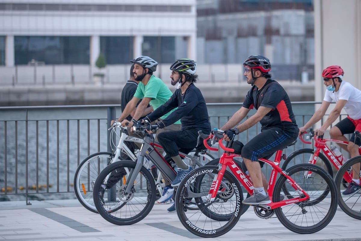 Sheikh Mohammed with his associated cycling in Dubai city. (Dubai Media City)
