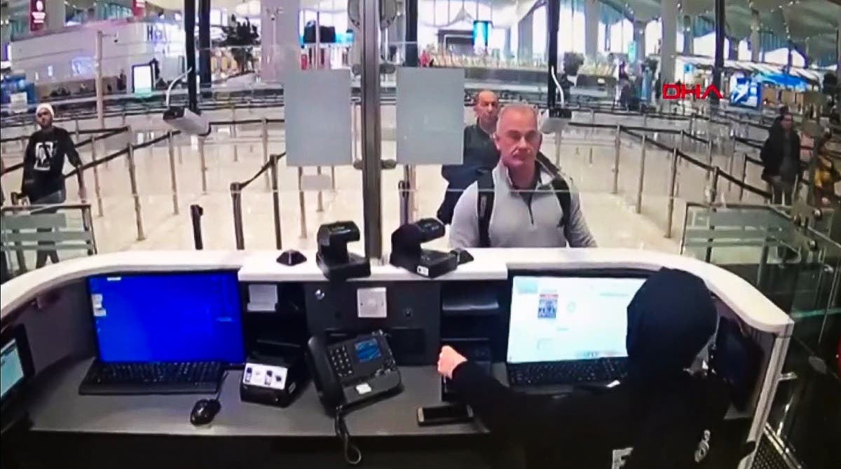 This handout video grab image released by The Istanbul Police Department to DHA News Agency on January 17, 2020, shows Michael Taylor (2R) and George Antoine Zayek (C) at passport control in Istanbul Airport, two men accused of helping fugitive businessman Ghosn escape. (File photo: AFP)