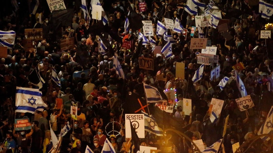 Thousands protest against Israel's Prime Minister Benjamin Netanyahu in front of his official residence in Jerusalem, on August 8, 2020. (AP)
