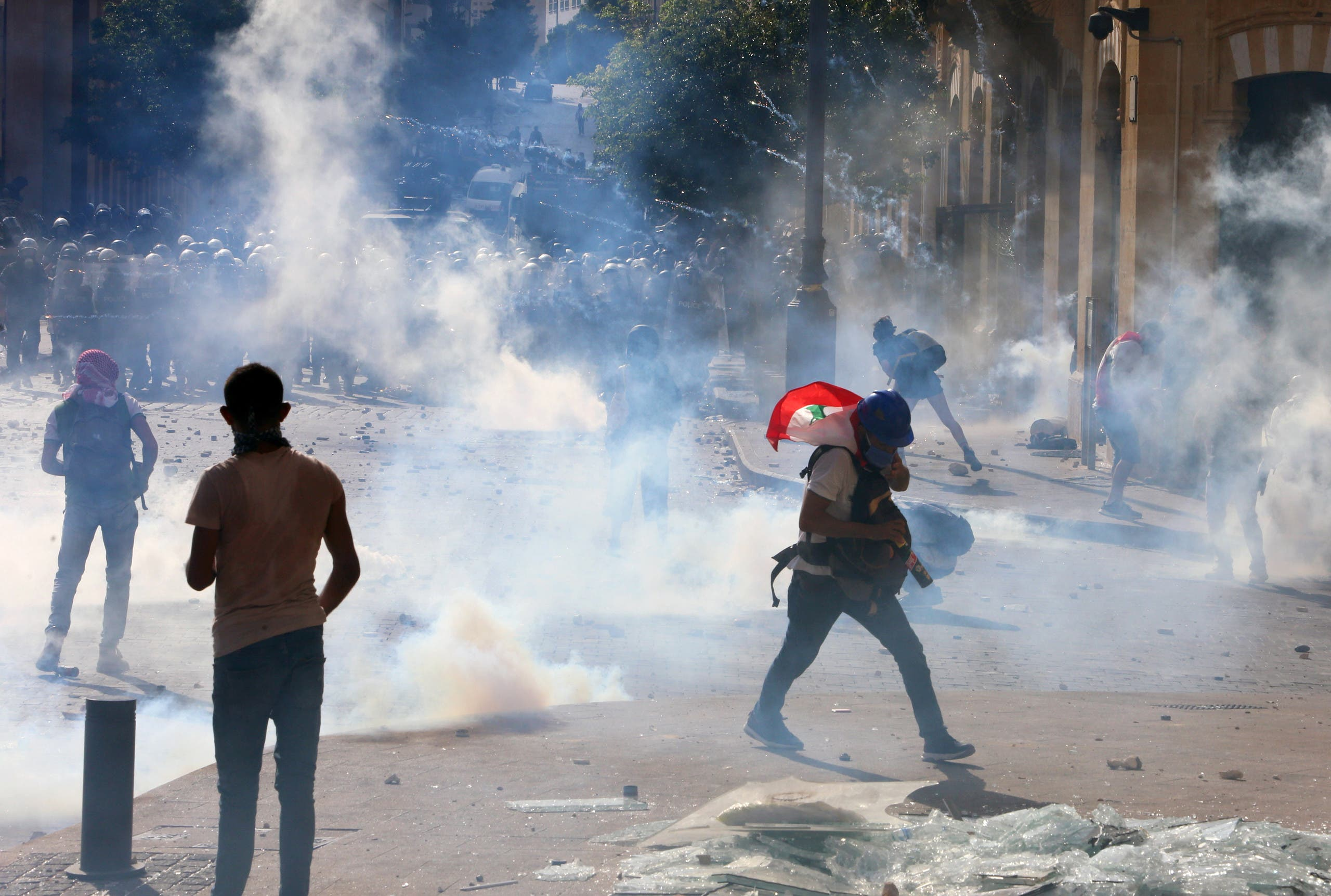 Demonstrators take part in a protest amid a cloud of tear gas fired by police, following Tuesday's blast, in Beirut, Lebanon August 8, 2020. (Reuters)