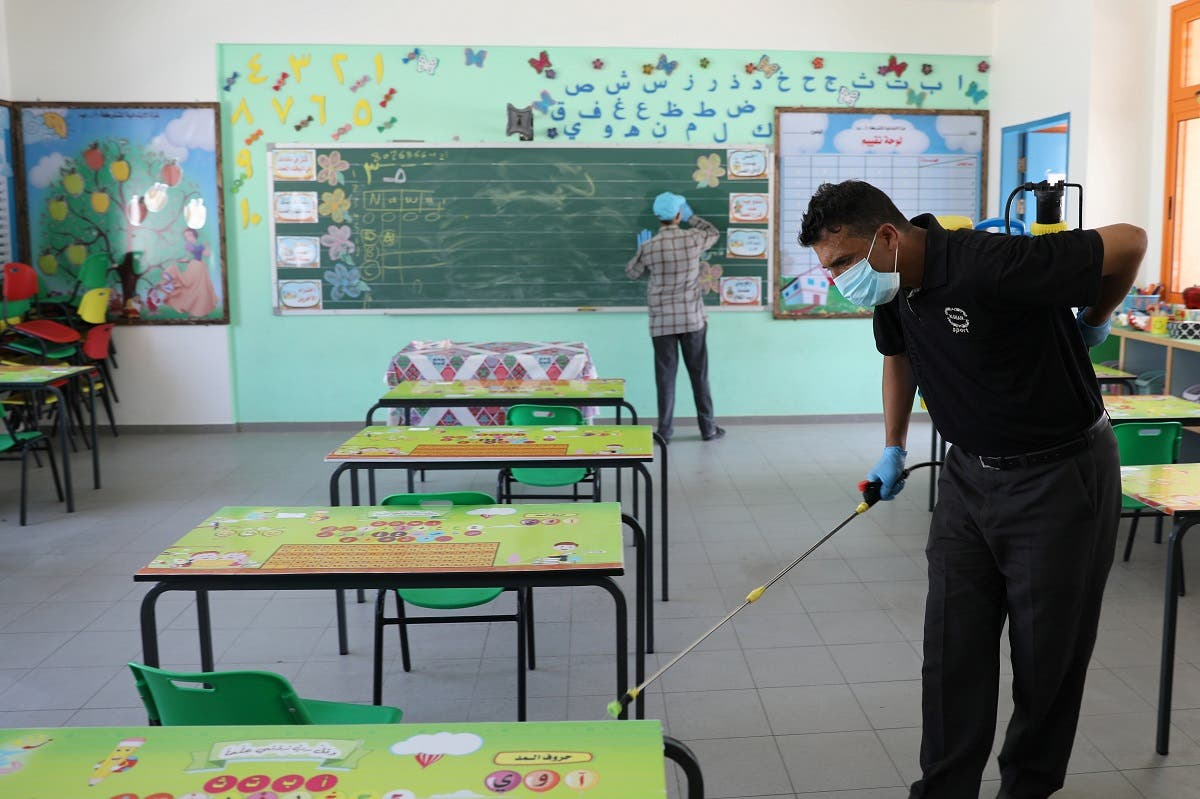 2020-A Palestinian worker wearing a protective face mask sanitizes a classroom in a UN-run school before a new academic year starts, amid concerns about the spread of the coronavirus in Gaza City, on August 4, 2020. (Reuters)08-04T104256Z_1206425693_RC2Y6I9Z6Y7A_RTRMADP_3_HEALTH-CORONAVIRUS-PALESTINIANS