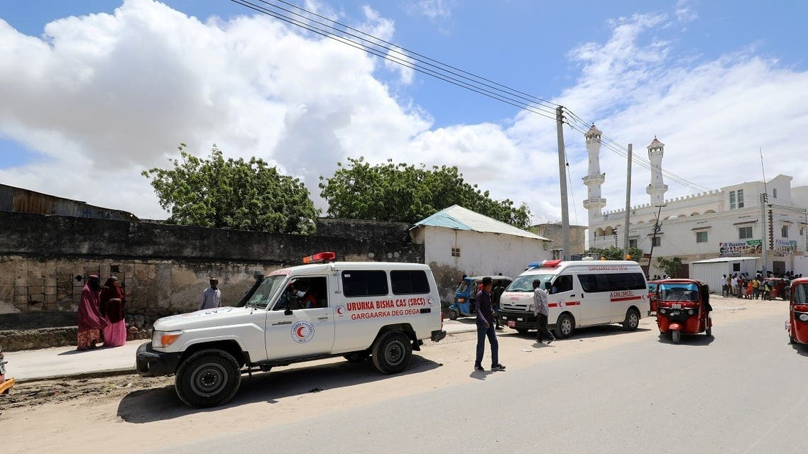 An ambulance is seen near a blast site that rocked a military base in Mogadishu, Somalia, on August 8, 2020. (Reuters)