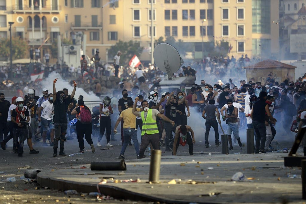 Lebanese protesters clash with security forces in downtown Beirut on August 8, 2020. (AFP)