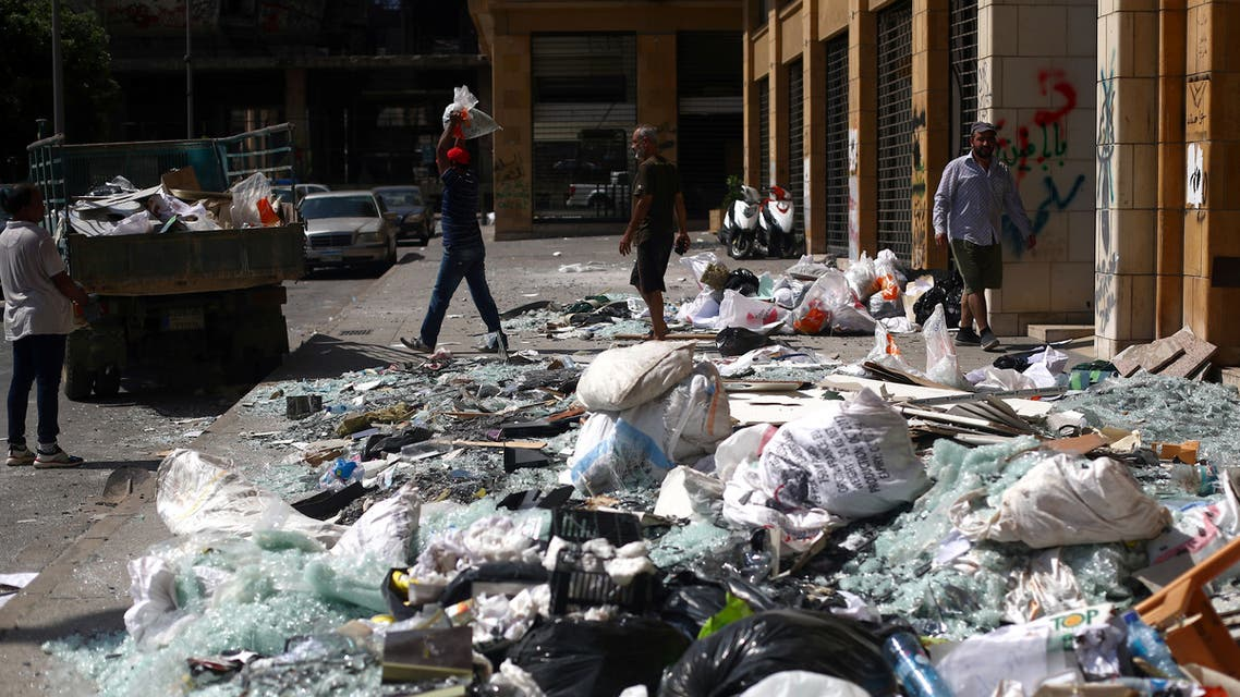 People clean debris from the street following Tuesday's blast in Beirut's port area, Lebanon August 8, 2020. (Reuters)