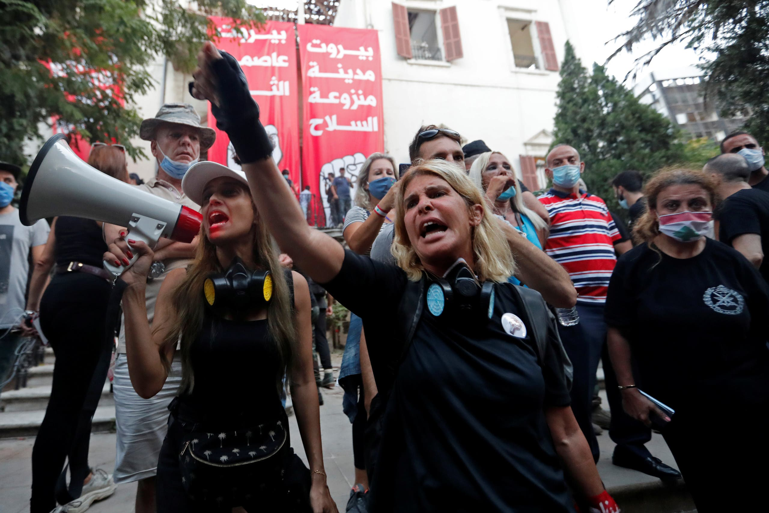 Demonstrators chant slogans outside the premises of the Lebanese foreign ministry during a protest following Tuesday's blast, in Beirut, Lebanon August 8, 2020. (Reuters)