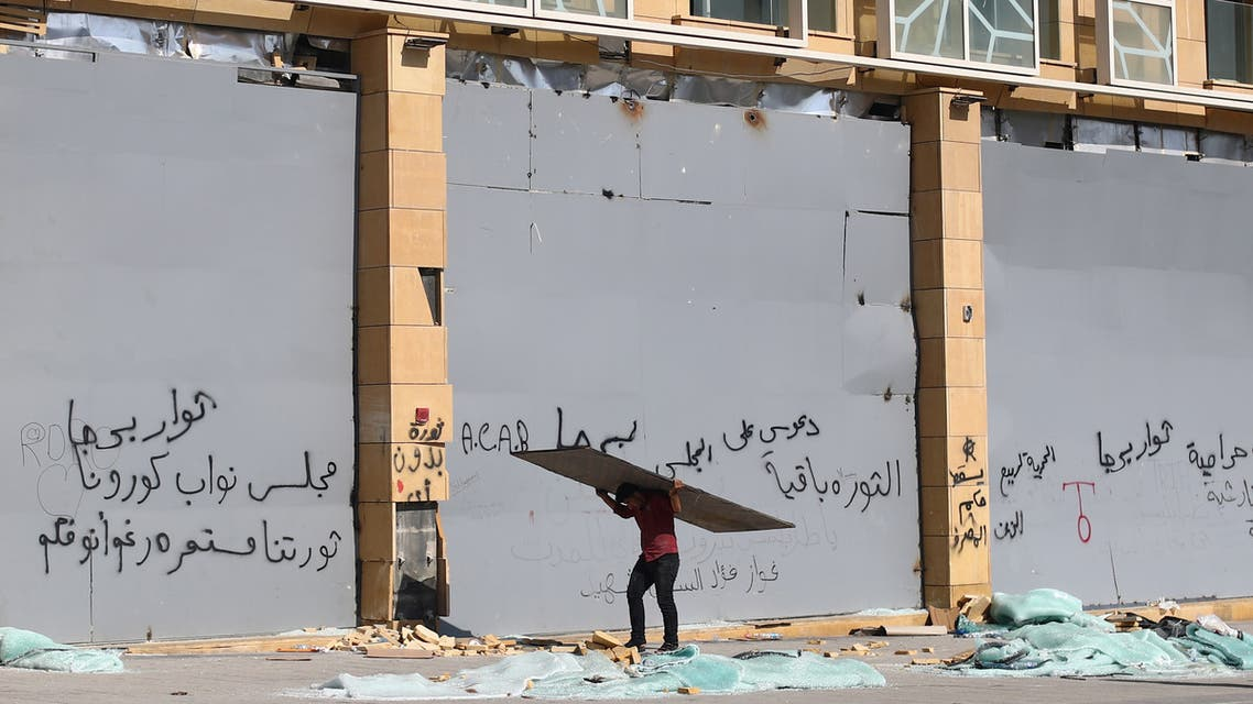 A man carries a board following Tuesday's blast in Beirut's port area, Lebanon August 8, 2020. (Reuters)