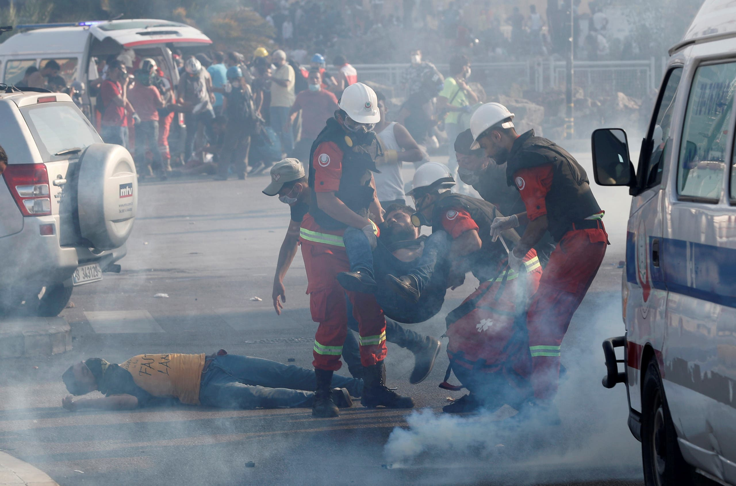 Rescuers assist demonstrators during a protest, following Tuesday's blast, in Beirut, Lebanon August 8, 2020.(Reuters)