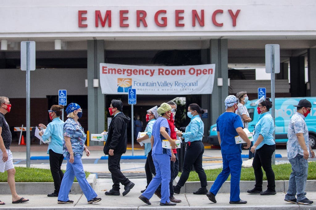Healthcare workers hold a rally outside their hospital for safer working conditions during the outbreak of the coronavirus in California, US, August 6, 2020. (Reuters)