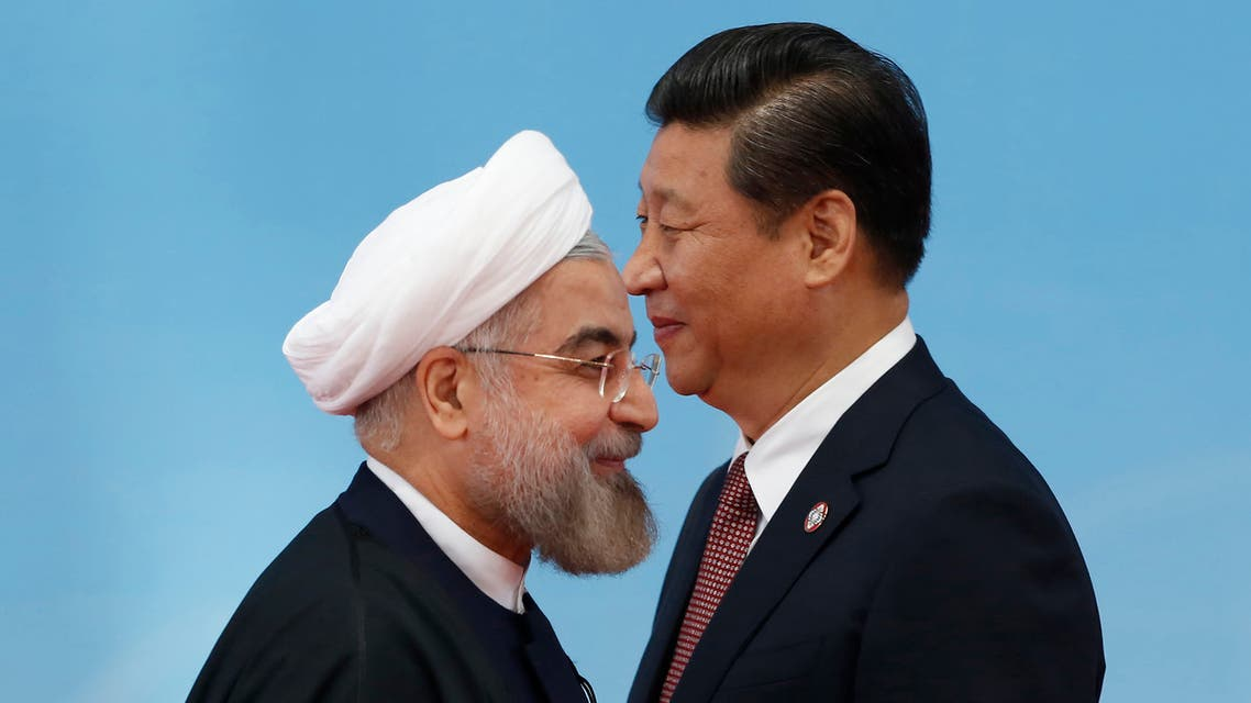Iran's President Hassan Rouhani (L) shaking hands with Chinese President Xi Jinping in Shanghai May 21, 2014. (File photo: Reuters)