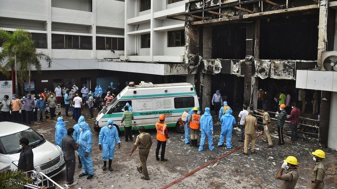 2020-08Rescue workers look for survivors after a fire broke out in a hotel that was being used as a coronavirus disease (COVID-19) facility in Vijayawada, in the southern state of Andhra Pradesh, India, on August 9, 2020. (Reuters)-09T045830Z_488982704_RC24AI9G6V3M_RTRMADP_3_HEALTH-CORONAVIRUS-INDIA-FIRE
