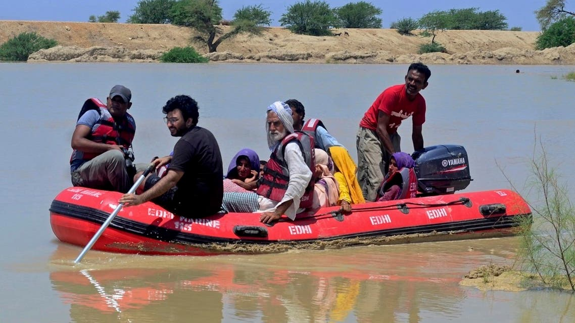 Pakistani rescue workers evacuate villagers from flooded areas of Dadu, a district in Pakistan's southern Sindh province, on August 9, 2020. (AP)