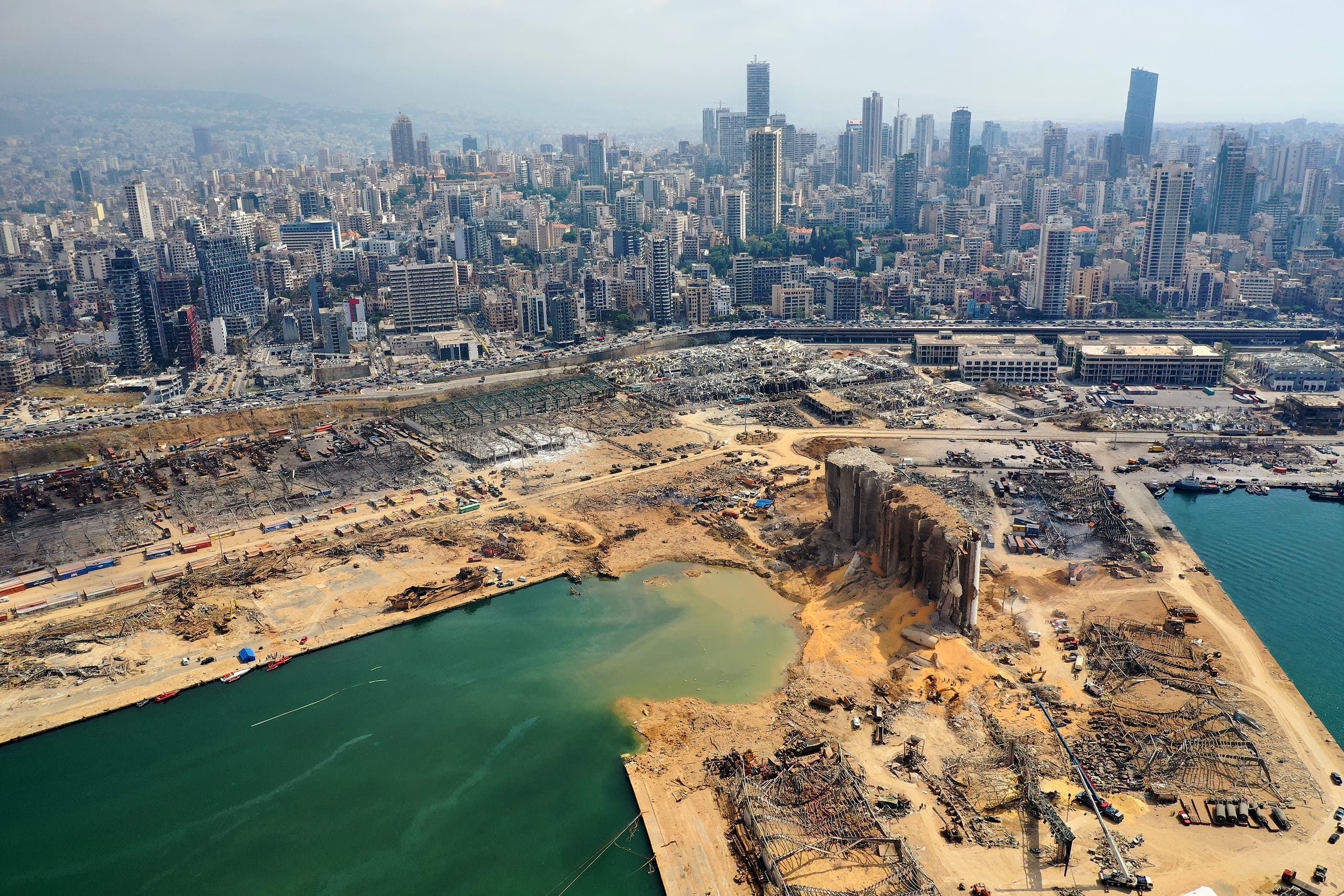 An aerial view taken on August 7, 2020, shows a partial view of the port of Beirut and the crater caused by the colossal explosion. (AFP)