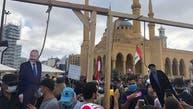 دستگیری عامل شکستن قاب عکس عون و درگیریهای پراکنده در محوطه مجلس لبنان