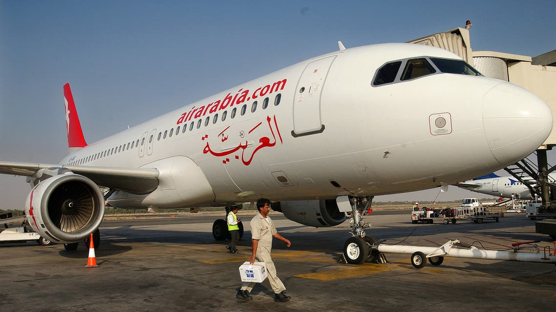 A worker walks past an Air Arabia plane. (File photo: Reuters)