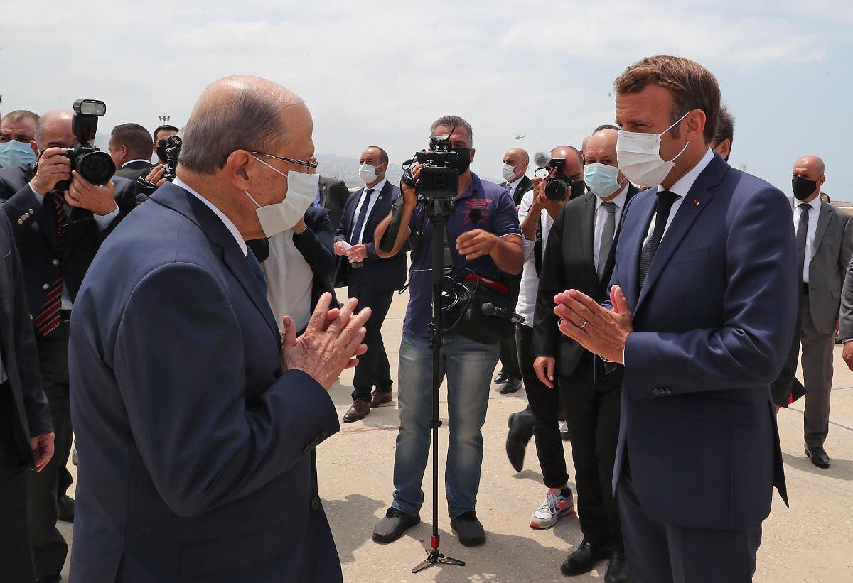 Lebanon's President Michel Aoun (L) receiving French President Emmanuel Macron at the Beirut airport Aug. 6, 2020. (AFP)