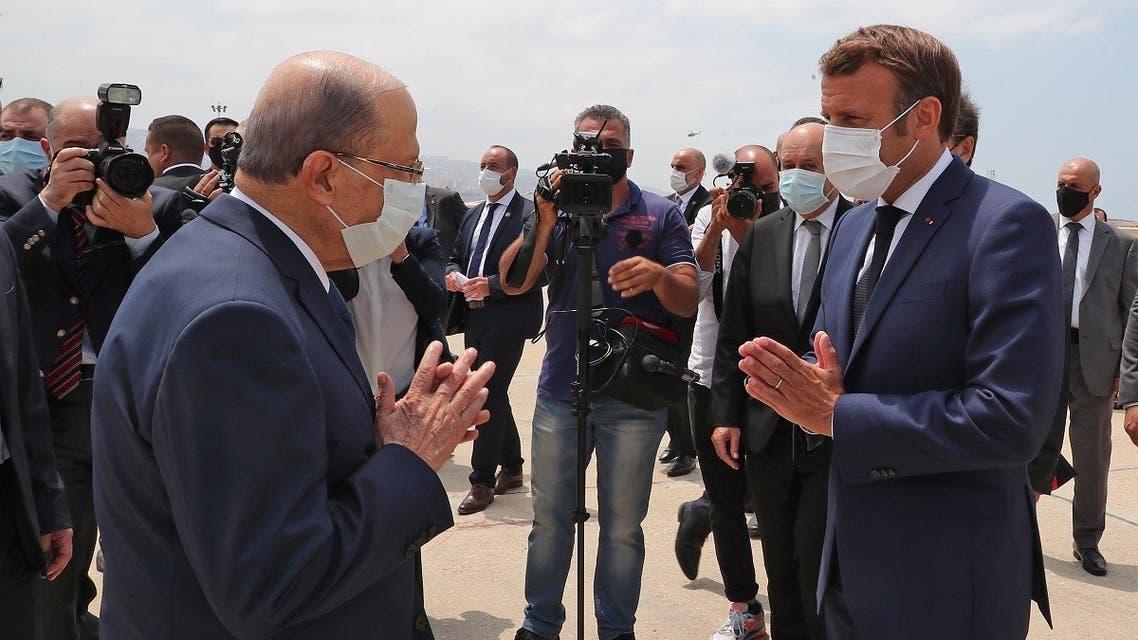 Lebanon's President Michel Aoun (L) receiving French President Emmanuel Macron at the Beirut airport Aug. 6, 2020. (AFP)