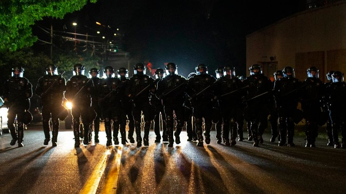 Portland police officers walk through a neighborhood after dispersing a protest of about 200 people from in front of a county Sheriff's Office, Aug. 8, 2020 in Portland. (File Photo: AP)