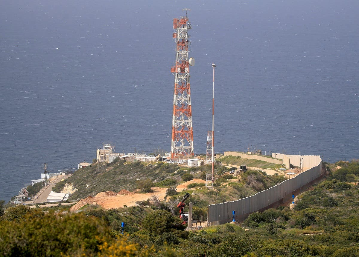 An Israeli crane erects a wall near border, as seen from Lebanon, near the village of Naqoura, March 6, 2018. (File Photo: Reuters)