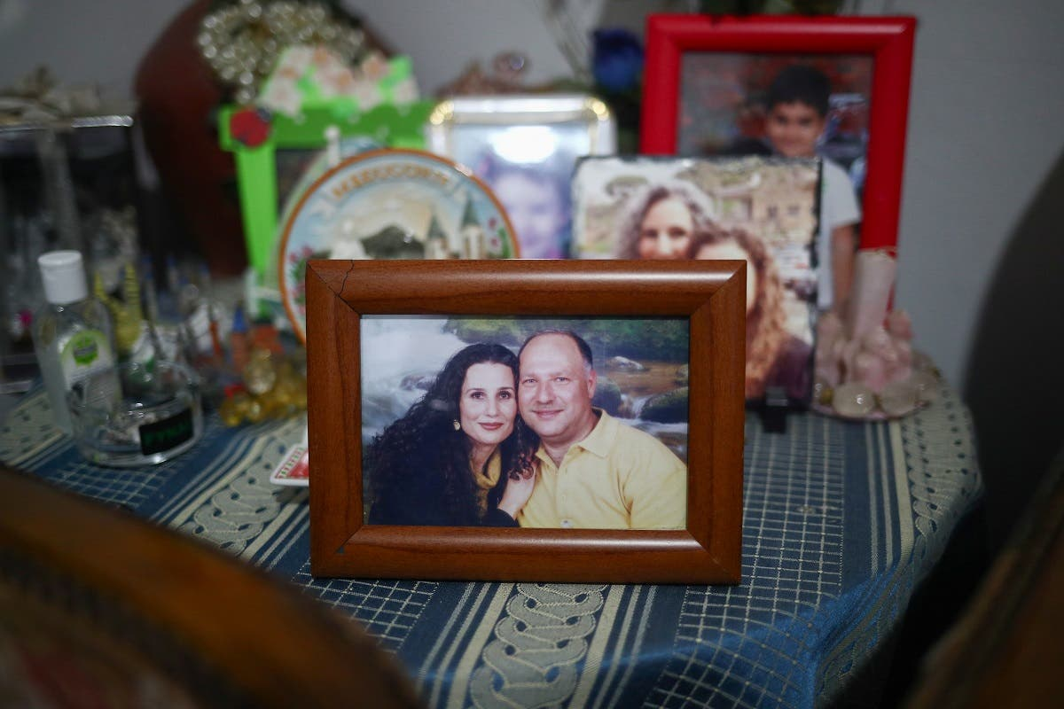 A photograph of the missing silo employee Ghassan Hasrouty pictured with his wife Ibtissam in the family home, following Tuesday's blast in Beirut's port area. (Reuters)