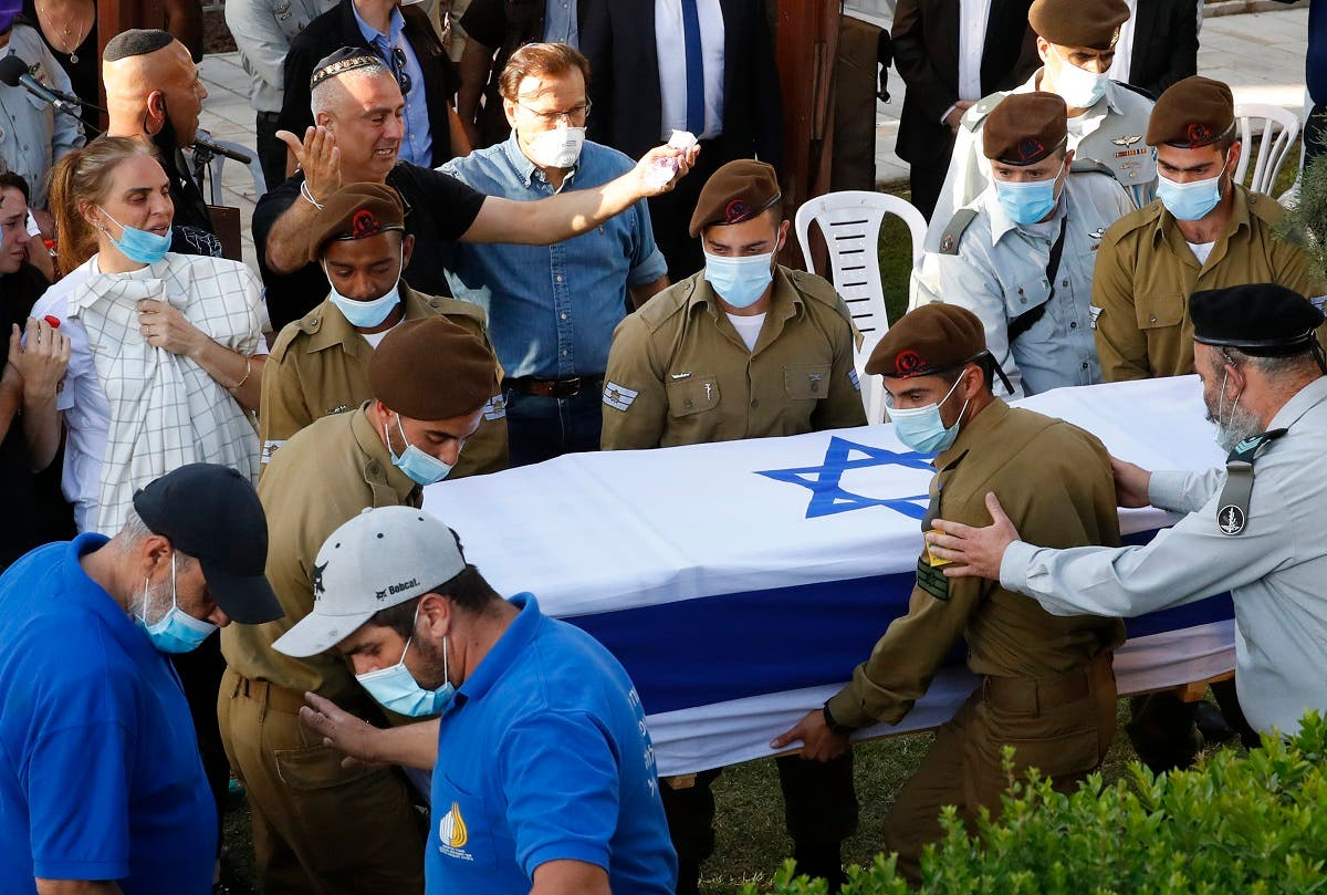 Family members and friends mourn during the funeral of Amit Ben Ygal, a 21-year-old Israeli army soldier who was killed in the village of Yaabed near the West Bank city of Jenin on May 12, 2020. (AFP)