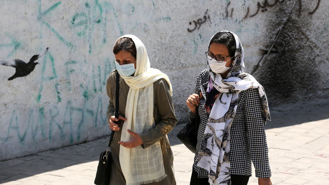 Iranian women wearing face masks walk down a street in the capital Tehran amid the novel coronavirus pandemic on August 9, 2020.
