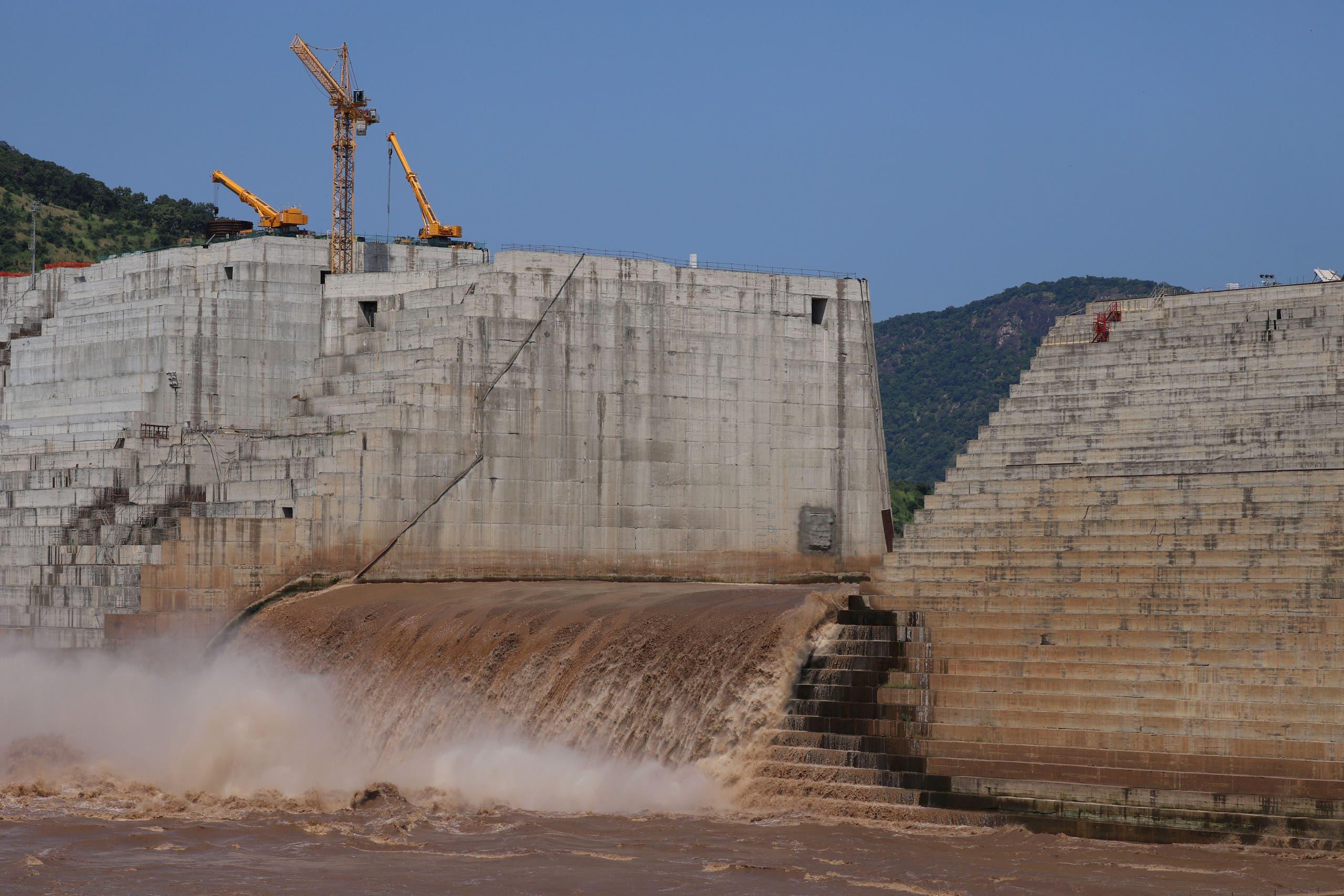 Water flows through Ethiopia's Grand Renaissance Dam as it undergoes construction work on the river Nile in Guba Woreda, Benishangul Gumuz Region, Ethiopia September 26, 2019. Picture taken September 26, 2019. (Reuters)